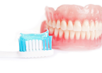 dentures with toothbrush