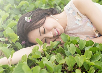 Woman laying in grass outdoors