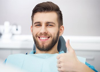 Thumbs up in dental chair