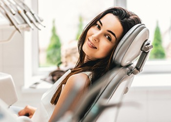 woman happy in dental chair