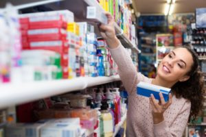 woman wonders how to choose toothpaste in South Windsor
